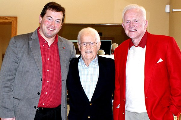 bob-cheyne-center-is-pictured-with-university-of-arkansas-associate-athletics-director-kevin-trainor-left-and-former-razorbacks-football-coach-and-athletics-director-frank-broyles-right-during-an-event-in-2012