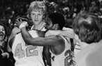 Indiana State star Larry Bird, center facing camera, embraces teammates Alex Gilbert, left, and Carl Nicks after the Sycamores beat Arkansas, 73-71, for the NCAA Midwest Regional crown on March 19, 1979, in Cincinnati. (AP Photo/File)