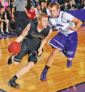 FILE PHOTO ANDY SHUPE Jake Caudle, left, of Bentonville drives Feb. 28 against Fayetteville's Mason Adams. Caudle may have provided Bentonville with its most pleasant surprise with his play during the season.