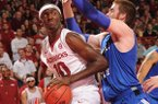 Arkansas forward Bobby Portis, left, makes a move to the basket as Indiana State forward Justin Gant defends during the second half Tuesday, March 18, 2014, at Bud Walton Arena in Fayetteville.