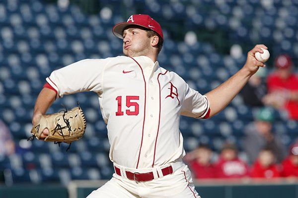 Arkansas starting pitcher Colin Poche pitches during first inning play Tuesday night March 18, 2014 at Baum Stadium in Fayetteville against visiting Grambling State.