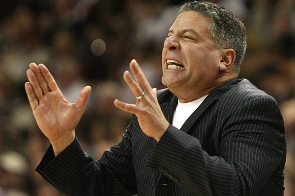 In this March 6, 2010 file photo, Tennessee head coach Bruce Pearl reacts during the second half of an NCAA college basketball game in Starkville, Miss. Auburn has hired former Tennessee coach Pearl to lead a struggling basketball program. The school announced the hiring on Tuesday, March 18, 2014, of the charismatic coach, who remains under a show-cause penalty from the NCAA. (AP Photo/Kerry Smith, File)