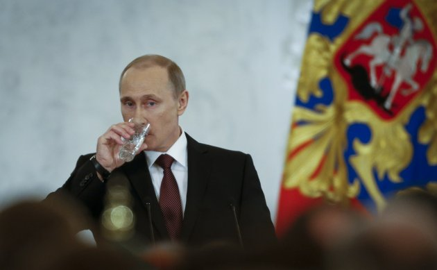 russian-president-vladimir-putin-drinks-water-as-he-addresses-the-federal-assembly-in-the-kremlin-in-moscow-tuesday-march-18-2014-with-a-sweep-of-his-pen-president-vladimir-putin-added-crimea-to-the-map-of-russia-on-tuesday-describing-the-move-as-correcting-past-injustice-and-a-response-to-what-he-called-western-encroachment-upon-russias-vital-interests