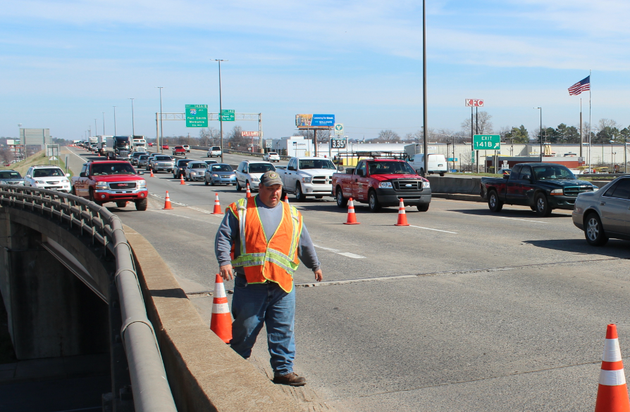 an-arkansas-state-highway-and-transportation-department-worker-arranges-cones-tuesday-during-maintenance-work-on-and-near-the-interstate-30-river-bridge