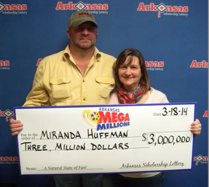 miranda-huffman-and-her-husband-jeff-pose-with-an-oversized-check-in-this-photo-released-by-the-arkansas-scholarship-lottery