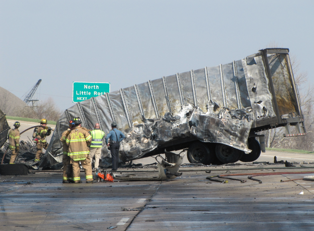 firefighters-work-around-the-wreckage-of-a-truck-that-caught-fire-in-a-wreck-wednesday-on-interstate-440-in-little-rock