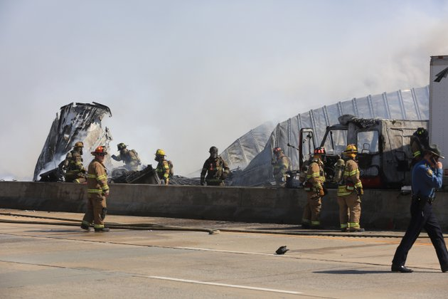 little-rock-firefighters-and-state-police-work-the-scene-of-an-accident-wednesday-afternoon-involving-two-18-wheelers-that-both-caught-fire-on-interstate-440-eastbound-just-before-the-bridge-over-the-arkansas-river-in-little-rock