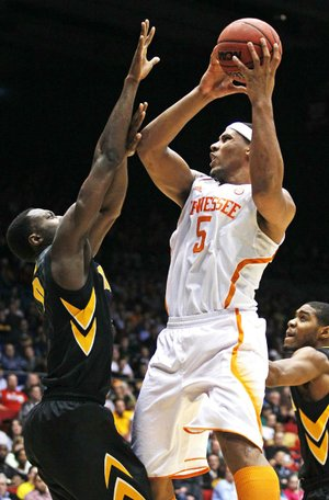 Tennessee forward Jarnell Stokes (5) shoots over Iowa center Gabriel Olaseni on Wednesday in the second half of the Volunteers' 78-65 overtime victory in the NCAA Tournament in Dayton, Ohio. Stokes scored 18 points and grabbed 13 rebounds in the victory.