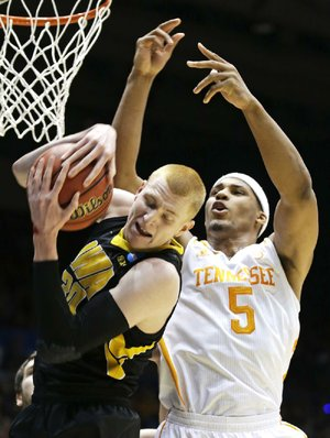Tennessee's Jarnell Stokes (5) and Iowa's Aaron White fi ght for a rebound during Wednesday night's game.
