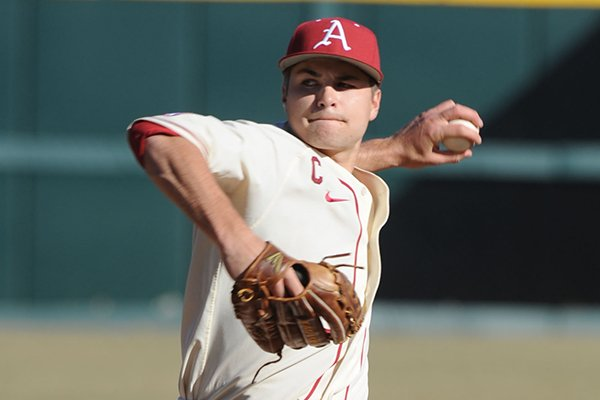 Arkansas junior pitcher Jalen Beeks delivers a pitch against Eastern Illinois during the first inning Friday, Feb. 21, 2014, at Baum Stadium in Fayetteville.