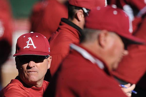 Arkansas coach Dave Van Horn watches from the dugout Tuesday, March 26, 2013, during the seventh inning of play against Mississippi Valley State at Baum Stadium in Fayetteville.