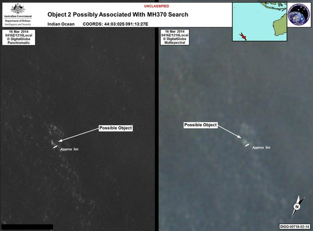 in-this-march-16-2014-satellite-imagery-provided-by-commonwealth-of-australia-department-of-defence-on-thursday-march-20-2014-a-floating-object-is-seen-at-sea-next-to-the-descriptor-which-was-added-by-the-source-australias-government-reported-thursday-march-20-2014-that-the-images-show-suspected-debris-from-the-missing-malaysia-airlines-jetliner-floating-in-an-area-1550-miles-southwest-of-perth-australia