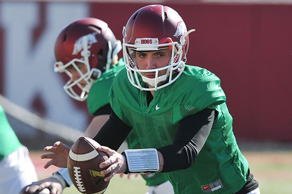 Arkansas quarterback Brandon Allen runs drills during practice Thursday, March 20, 2014 in Fayetteville.