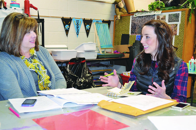 tracy-roberts-left-and-leigh-ann-veach-discuss-plans-for-the-2014-relay-for-life-for-pope-and-yell-counties-the-relay-will-be-held-april-25-26-at-the-pope-county-fairgrounds-in-russellville