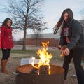 Hope Ledbetter, right, senior at Springdale High School, gets a fire started as Jemini Patel, left, ...