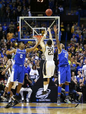 The potential game-winning shot by Wichita State Shockers guard Fred VanVleet (23) was off the mark as he was defended by Kentucky Wildcats guard Aaron Harrison (2) and Willie Cauley-Stein during the third round of the NCAA Tournament in St. Louis on Sunday, March 23, 2014. The Kentucky Wildcats defeated the Wichita State Shockers, 78-76. (Mark Cornelison/Lexington Herald-Leader/MCT)
