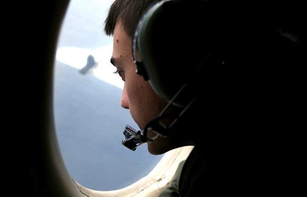 in-this-march-22-2014-file-photo-sgt-matthew-falanga-on-board-a-royal-australian-air-force-ap-3c-orion-search-for-the-missing-malaysia-airlines-flight-mh370-in-southern-indian-ocean-australia-not-one-object-has-been-recovered-from-the-missing-airliner-that-malaysian-officials-are-now-convinced-plunged-into-the-southern-indian-ocean-17-days-ago