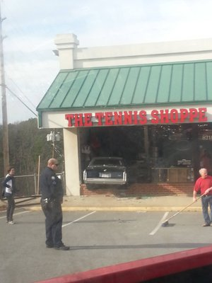 A Cadillac crashed into The Tennis Shoppe at 8218 Cantrell Road in Little Rock on Wednesday afternoon, injuring two employees inside the business.