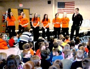 "Submitted Photo Several members of the Gravette Lady Lions basketball team and their coach, Will Pittman, attended the March ""Rise and Shine"" assembly at Glenn Duffy Elementary School. They demonstrated and told how important it is to help each other at school and elsewhere through communication with each other and planning to get a job done. The girls, left to right are, Maddie Foster, Sydney Hicks, Ella Duke, Samantha Linn, Kayla Kardynalski, Haleigh Perry, Kylee Davis and Coach Pittman."