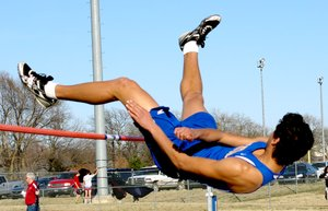 Photo by Mike Eckels Decatur Bulldog high jumper Mario Urquidi sails over the bar during Bentonville Tiger Relays March 20. Urquidi was competing with jumpers for Fayetteville, Springdale, Rogers, Bentonville, Ft. Smith and other area schools from 1A through 7A. He placed 6th in the event.