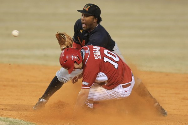 Arkansas' Joe Serrano (10) steals second base as Mississippi Valley's Xzavier Franklin awaits the throw in their game at Dickey-Stephens Park in North Little Rock Wednesday.