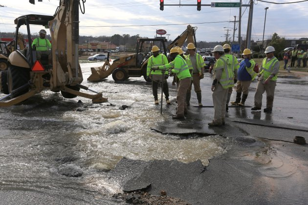 central-arkansas-water-crews-work-a-stop-the-flow-of-water-from-a-busted-water-main-at-the-intersection-of-south-university-avenue-and-asher-avenue-in-little-rock-wednesday-evening-traffic-was-being-diverted-and-not-allowed-into-the-intersection
