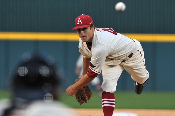 University of Arkansas pitcher Jalen Beeks fires a pitch against Alabama at Baum Stadium in Fayetteville March 21.