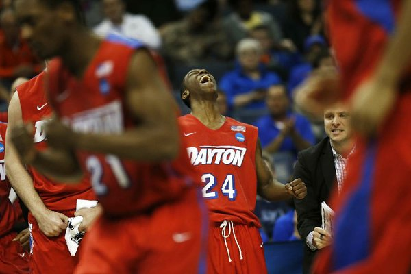 Dayton guard Jordan Sibert (24) celebrates a three-point shot against Stanford during the second half in a regional semifinal game at the NCAA college basketball tournament, Thursday, March 27, 2014, in Memphis, Tenn. Dayton won 82-72. (AP Photo/John Bazemore)