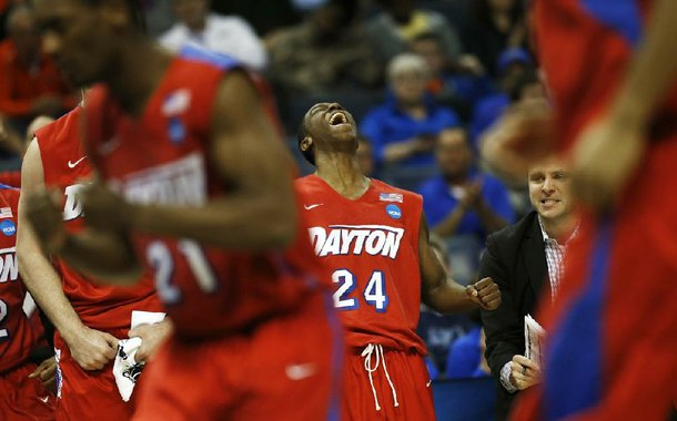Dayton guard Jordan Sibert (24) celebrates a three-point shot against Stanford during the second half in a regional semifinal game at the NCAA college basketball tournament, Thursday, March 27, 2014, in Memphis, Tenn. Dayton won 82-72. (AP Photo/John Bazemore)