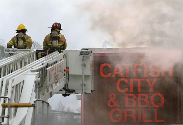 little-rock-firefighters-use-a-ladder-truck-to-access-the-roof-of-catfish-city-on-university-ave-while-responding-to-a-fire-in-the-restaurant-on-friday-afternoon