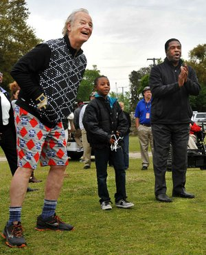 Bill Murray (left) had no problems laughing at his wardrobe Friday during his charity golf tournament in Florida.