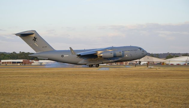 in-this-friday-march-28-2014-photo-released-by-the-australian-defence-a-royal-australian-air-force-c-17-globemaster-arrives-to-help-with-the-search-for-the-missing-malaysia-airlines-flight-370-at-raaf-pearce-base-in-perth-australia-objects-spotted-floating-in-a-new-search-area-for-debris-from-the-missing-malaysian-jetliner-need-to-be-recovered-and-inspected-before-they-can-be-linked-to-the-plane-australian-officials-said-saturday-eight-planes-were-ready-to-comb-the-newly-targeted-area-off-the-west-coast-of-australia-after-several-objects-were-spotted-friday-including-two-rectangular-items-that-were-blue-and-gray-and-ships-on-the-scene-will-attempt-to-recover-them-the-australian-maritime-safety-authority-said