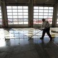 NWA Media/ANDY SHUPE - Chief Mark Cunningham of the Farmington Fire Department uses a squeegee to cl...
