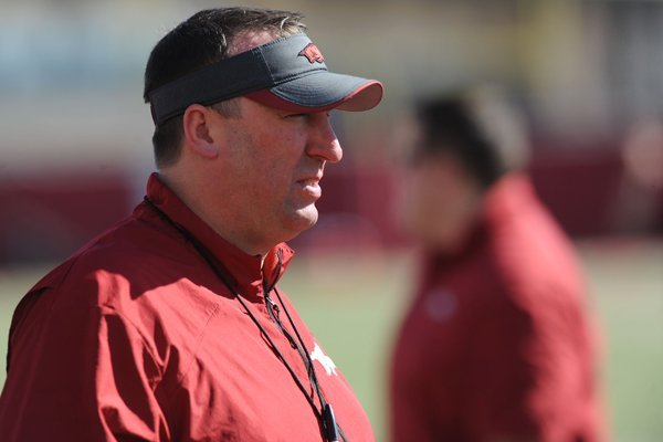 Arkansas coach Bret Bielema watches his team during practice Thursday, March 20, 2014, at the UA practice field in Fayetteville.