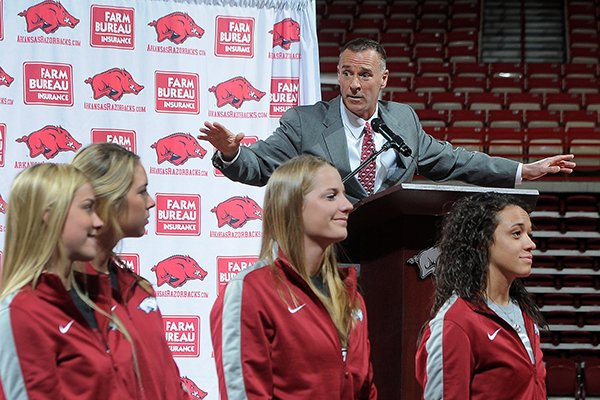 With his team in front of him, Jimmy Dykes speaks after being introduced as the eighth women's head basketball coach Sunday, March 30, 2014, at Bud Walton Arena in Fayetteville. Dykes left his job as an analyst for ESPN for the position. Dykes coached at Arkansas, Sacramento State, Appalachian State, Kentucky and Arkansas-Little Rock, and Oklahoma State.