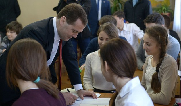 russian-prime-minister-dmitry-medvedev-second-left-speaks-to-schoolchildren-while-visiting-crimea-in-simferopol-crimea-on-monday-march-31-2014-russias-prime-minister-is-visiting-crimea-to-consider-priorities-for-its-economic-development-after-the-russian-takeover