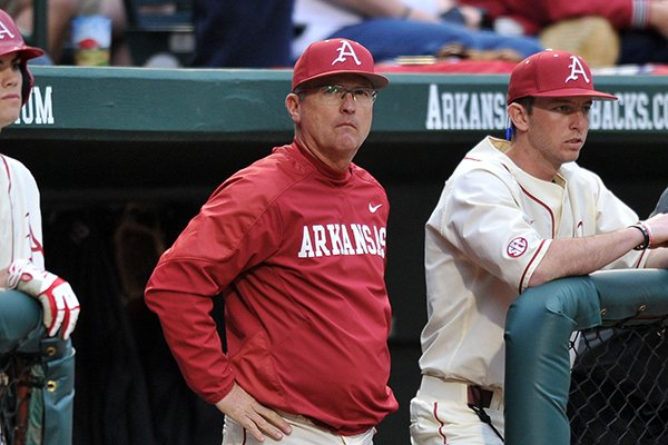 Arkansas coach Dave Van Horn watches from the dugout during the Razorbacks' 17-9 loss to Alabama on March 21, 2014 at Baum Stadium in Fayetteville.