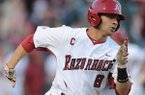 Arkansas center fielder Tyler Spoon heads to first after hitting a game-tying 2-run double during the third inning against Nebraska Tuesday, April 1, 2014, at Baum Stadium in Fayetteville.