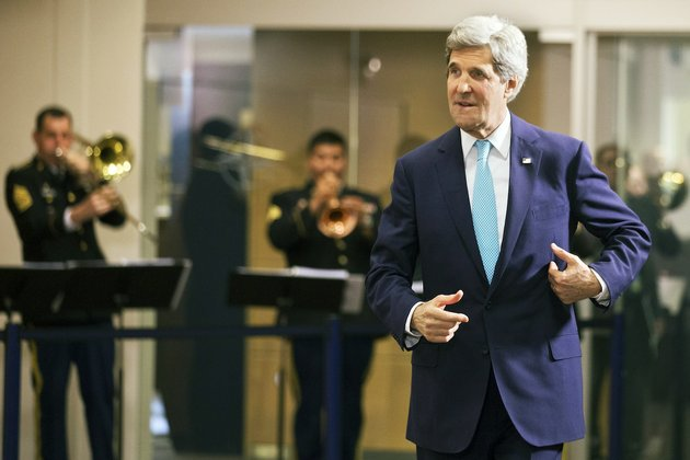 us-secretary-of-state-john-kerry-walks-through-nato-headquarters-after-attending-a-nato-enlargement-anniversary-ceremony-with-nato-foreign-ministers-in-brussels-tuesday-april-1-2014