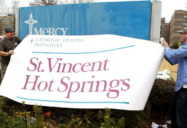 doug-hethcox-left-and-kyle-mccabe-of-ace-sign-co-put-up-a-new-sign-tuesday-outside-the-former-mercy-hot-springs-hospital-after-st-vincent-health-system-announced-its-acquisition-of-the-hospital
