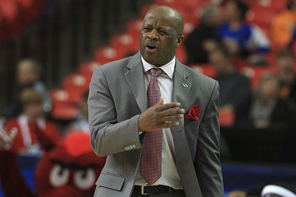 Arkansas coach Mike Anderson yells instruction sot his players Wednesday, March 13, 2014 during their SEC Tournament game at the Georgia Dome in Atlanta.