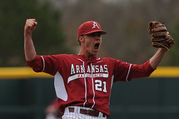 Arkansas starter Trey Killian celebrates the final out during the Hogs' 2-1 come-from-behind win over Alabama Saturday, March 22, 2014, at Baum Stadium in Fayetteville.