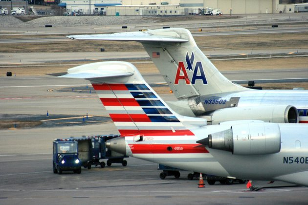 crews-work-around-two-american-airlines-jets-in-st-louis-in-this-december-2013-file-photo