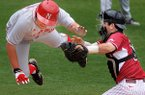 Arkansas' Jake Wise, right, manages to tag Nebraska's Ben Miller out at home in the second inning Wednesday, April 2, 2014, at Baum Stadium in Fayetteville.