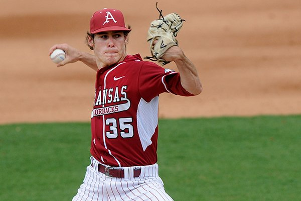 Arkansas' Jackson Lowery delivers a pitch Wednesday, April 2, 2014, during the game against Nebraska at Baum Stadium in Fayetteville.