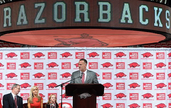 Jimmy Dykes speaks after being introduced as the eighth women's head basketball coach Sunday, March 30, 2014, at Bud Walton Arena in Fayetteville.