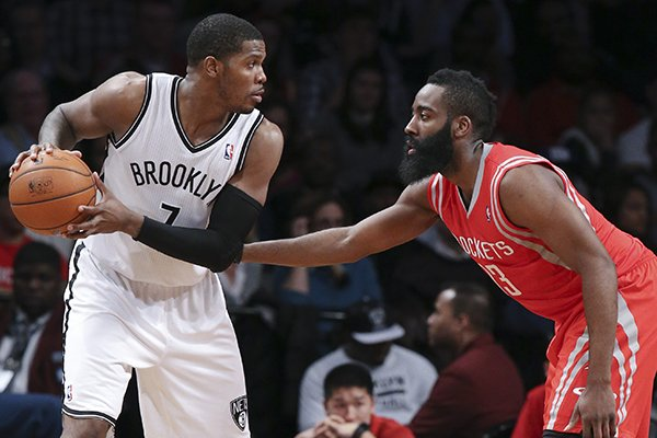 Brooklyn Nets guard Joe Johnson (7) and Houston Rockets guard James Harden (13) face off during the second half of their NBA basketball game at the Barclays Center, Tuesday, April 1, 2014, in New York. The Nets defeated the Rockets, 105-96. (AP Photo/John Minchillo)