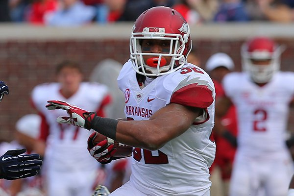 Arkansas' Jonathan Williams drives downfield in the fourth quarter during their game Saturday, Nov. 9, 2013 at Vaught-Hemingway Stadium in Oxford, Miss.