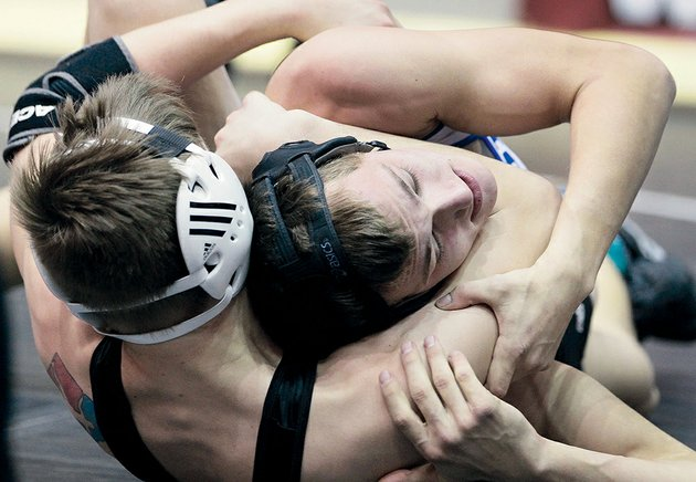 maumelles-justin-butler-left-defeated-bismarcks-aaron-whitehead-in-the-class-1a-5a-160-pound-weight-class-of-the-high-school-state-wrestling-tournament-the-victory-was-butlers-third-straight-state-championship