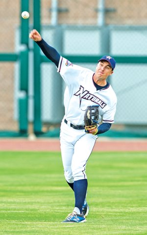 STAFF PHOTO ANTHONY REYES Lane Adams, Northwest Arkansas Naturals outfielder, throws to the infield Monday at Arvest Ballpark in Springdale.